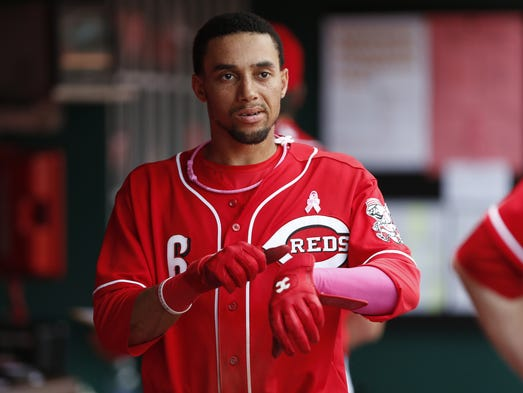 Cincinnati Reds center fielder Billy Hamilton (6) slips his gloves on during their game against the Colorado Rockies at Great American Ball Park.