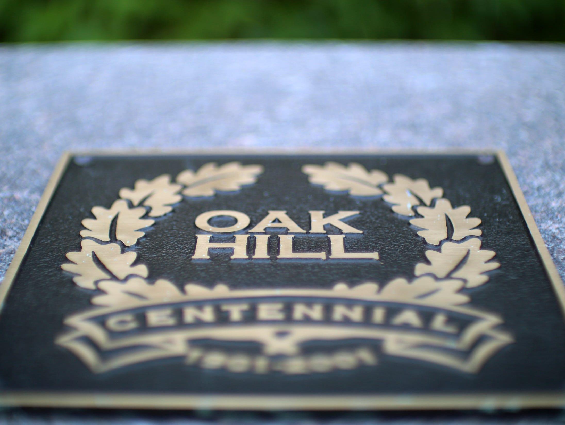 A plaque notes the Oak Hill centennial.