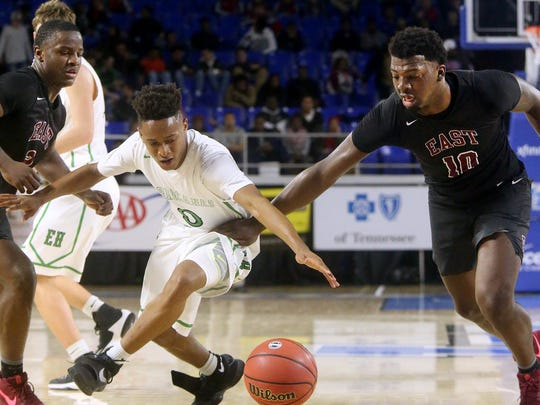 East Hamilton's Vandrele Sammons (0) goes for a loose ball between Memphis East's Alex Lomax (2) and Radarious Washington (10) during the quarterfinal round of the Class AAA State Tournament on Wednesday, March 15, 2017.