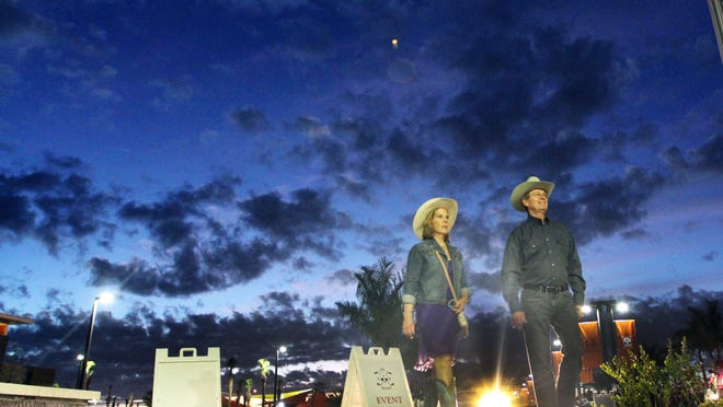 Tom and Keri Moorey, of Fort Myers, don their western gear as they arrive at the Cattle Barons' Ball at Six Bends Harley Davidson in Fort Myers on Saturday night.
