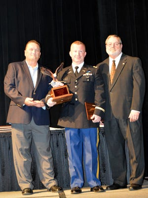 Army 2nd Lt. Kale Williams, center, one of 12 recipients of a Patriot Award on Sept. 7, given during an event sponsored by the Bossier Chamber of Commerce.