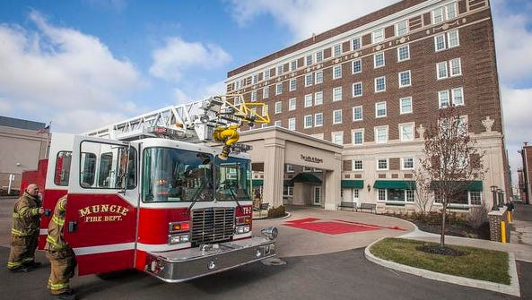 A fire in a seventh-floor apartment at The Lofts at Roberts led to a partial evacuation of residents Thursday morning. According to Battalion Chief Jim Clevenger, a woman was in the process of moving her mother into a seventh-floor apartment when she set a box of clothing on the apartment's stove before heading back to the bottom floor to retrieve more items.  Before the woman had returned, the building's sprinkler system activated, extinguishing the resulting fire. Firefighters performed a full sweep of the building and worked to limit water damage from the flooded seventh floor which was leaking water into lower floors of the building. A woman was checked by EMTs after she fell during the partial evacuation. No injuries were reported during the incident.