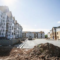 While hundreds of apartments have opened recently in Asheville, including the Avalon apartments off Sweeten Creek Road, here under construction in 2014, the Asheville area needs about 5,600 units to meet demand.