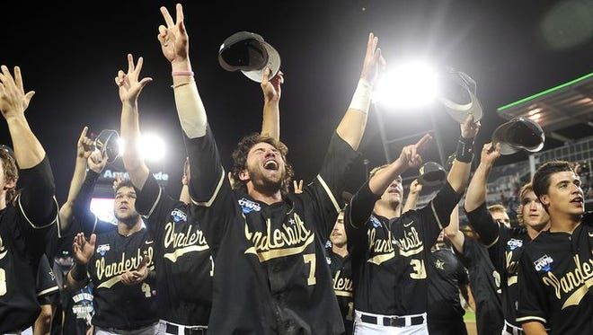 Vanderbilt players celebrate their 4-3, 10-inning win over Texas at the College World Series on Saturday. The Commodores advanced to the best-of-three national championship series with the win.