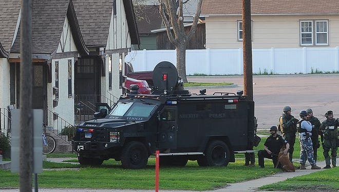 Standoff near 13th Street and Western Avenue on Wednesday, May 7, 2014.