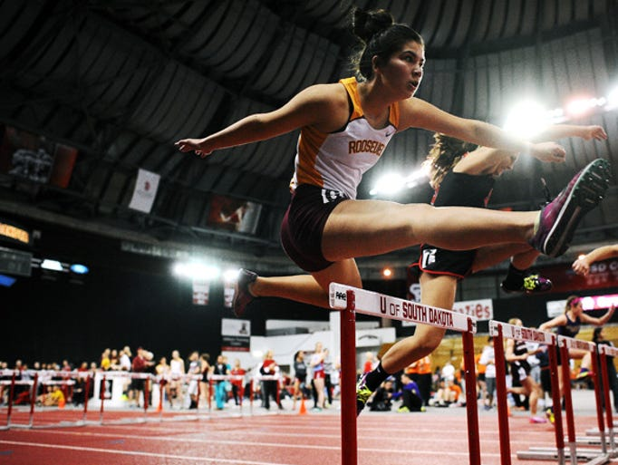 Roosevelt's Amber Hopkins participates in the girls 60-meter hurdles during the 2014 Dan Lennon Invitational Track Meet on Monday, March 24, 2014, at the DakotaDome in Vermillion, S.D.