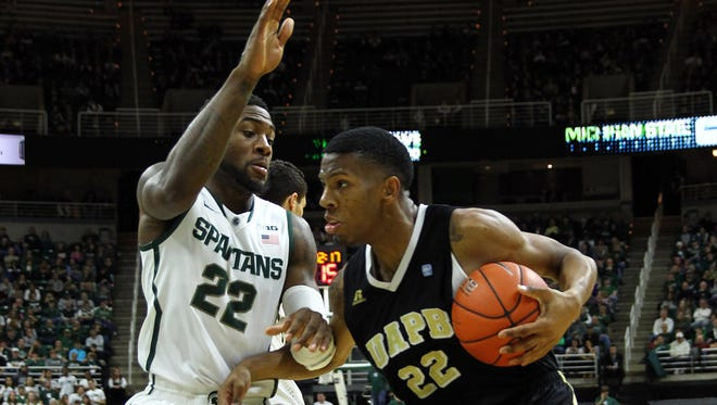 Arkansas-Pine Bluff's Jovaughn Love, here last December defended by MSU's Branden Dawson at Breslin Center, leads Pine Bluff in scoring, averaging 18 points per game.