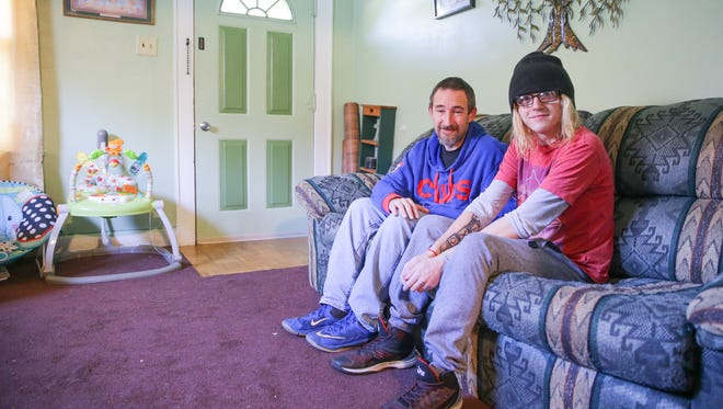 David Morgan, left, and his son Chris Morgan, right, sit in the living room at their Indianapolis home on Friday, Nov. 10, 2017. The two spoke out as child advocates after Chris lost his infant son Jaxon due to positional asphyxia.