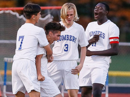 Sayreville players (from left) Tyler Barreiro, Joe Martinez, Frankie Astarita, Ope Olaloko and Kevin Sousa celebrate Martinez's opening goal against Woodbridge during their GMC Tournament preliminary round game on Oct. 19, 2016.
