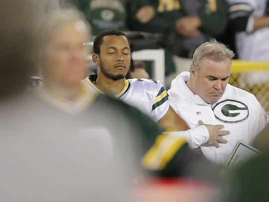 Green Bay Packers quarterback Brett Hundley and coach Mike McCarthy stand for the national anthem before the game against the Chicago Bears Thursday, Sept. 28, 2017 at Lambeau Field in Green Bay, Wis.
