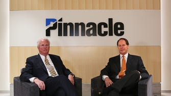 Pinnacle Financial Partners President and CEO Terry Turner, left, and Kirk Bailey, chairman of the Memphis branch, sit in their new office building at 949 South Shady Grove Road in the Ridgeway Center. Three years after Nashville-based Pinnacle Financial took over Magna Bank of Memphis, Pinnacle has made a mark in Memphis, not only with the new office building, but also sponsoring the Memphis Grizzlies and hiring talent away from First Tennessee.