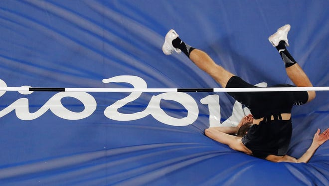Canada's Derek Drouin makes an attempt in the high jump during a qualifying round at the athletics competitions of the 2016 Summer Olympics at the Olympic stadium in Rio de Janeiro, Brazil, Sunday, Aug. 14, 2016. (AP Photo/Morry Gash)