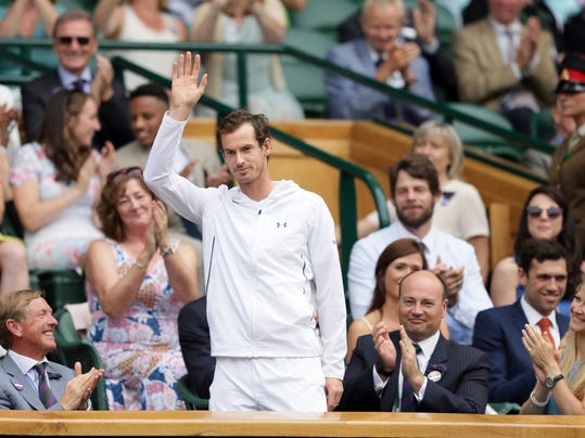 Britain's Andy Murray, centre, takes his seat on center court on day six at the Wimbledon Tennis Championships in London Saturday, July 8, 2017. (AP Photo/Tim Ireland)