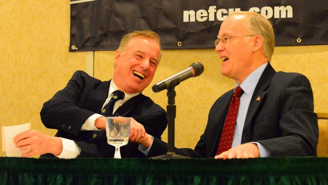 Former Vermont governors Howard Dean, left, and Jim Douglas, shake hands at the end of a panel discussion on how long the term for the state's governor should be at the Lake Champlain Regional Chamber of Commerce legislative breakfast at the DoubleTree by Hilton Burlington in South Burlington Monday, Jan. 11, 2016.