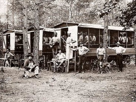 A typical convict camp in 1910 in Florida, with guards, convicts, housing and supplies.