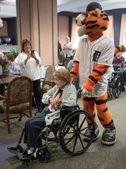 Tigers mascot Paws dances with birthday girl Regina