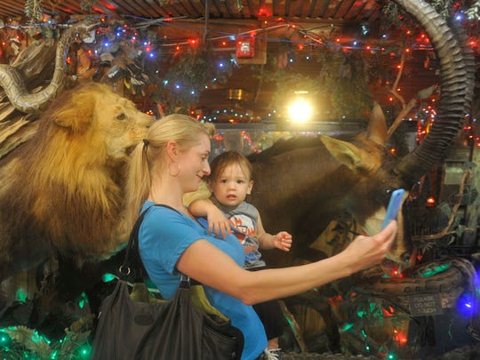 Babs Gramsky and her 14-month-old son, Aixel, take a selfie in front one of hundreds of taxidermy animals at Clark's Fish Camp in Jacksonville on Tuesday, Dec. 29, 2015.