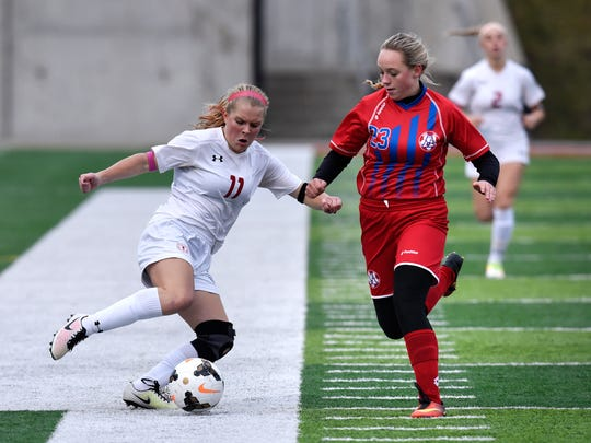 Claire Van der Heide of Benilde-St. Margarets and Chloe Swanson of Apollo square off during the first half of the Thursday, Oct. 27, game at Husky Stadium in St. Cloud.