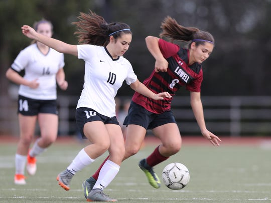 U-Prep's Haley Bramante, left, fights for the ball against Lowell's Natalia Potente during a 2018 playoff game.