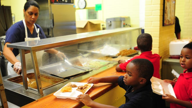 First grade students are served lunch in the school cafeteria at Myrtle Place Elementary in Lafayette, LA, Thursday, Aug. 22, 2013. Paul Kieu, The Advertiser
