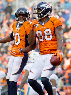 Broncos receivers Demaryius Thomas (88) and Emmanuel Sanders won't be reunited until Thomas reports to the team.