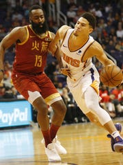 Houston Rockets guard James Harden (13) fouls Phoenix
