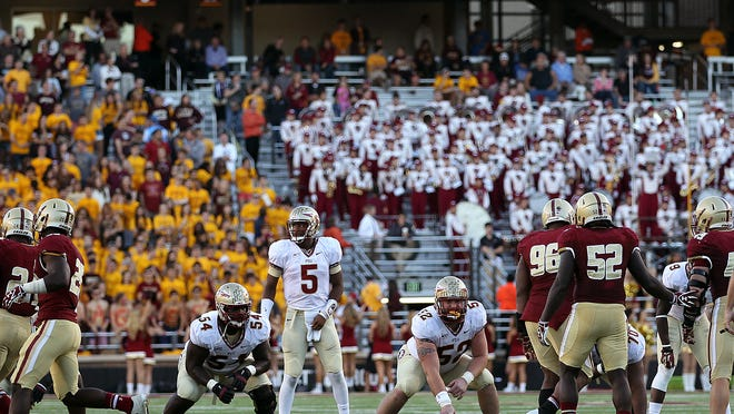 Jameis Winston scans the defense during Florida State's comeback win at Boston College in 2013.