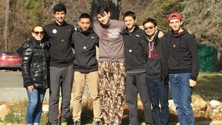 Jeffrey Hoens, center, pictured with a group of friends.