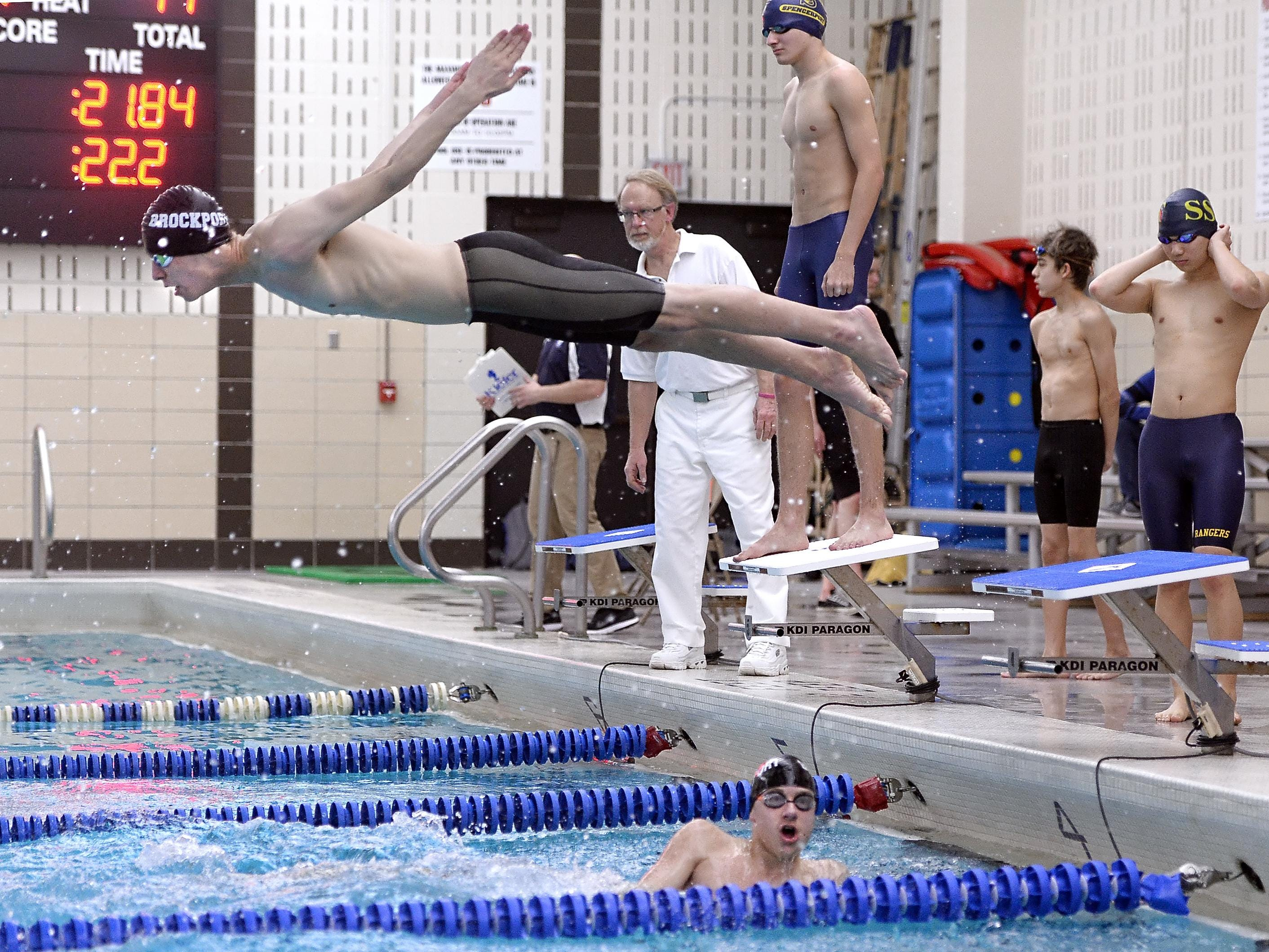 Brockport's Alex Regna, top, leaves the starting block over teammate Brandon Amthor as they compete in the 200-yard freestyle relay.