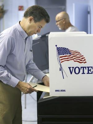 Kansas Gov. Sam Brownback votes Monday  in Topeka.