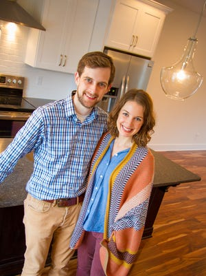 Martin and Ellen Ross, first-time homebuyers, are moving into a new townhome built by Carbine & Associates, a company best known for luxurious homes in suburban Green Hills and Williamson County.