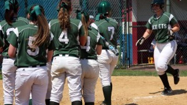 Raritan's Bethany Evans is met at home by teammates following a home run.