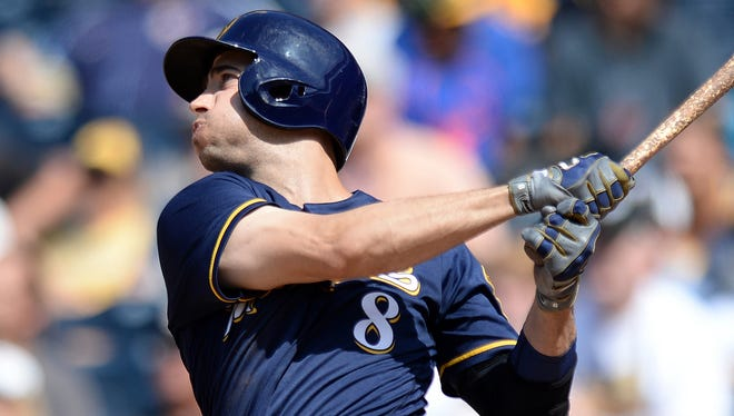 Ryan Braun hits a two-run homer against the Padres last August.
