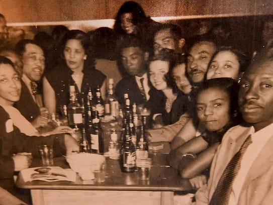 A photo shows jazz great Duke Ellington, far left,