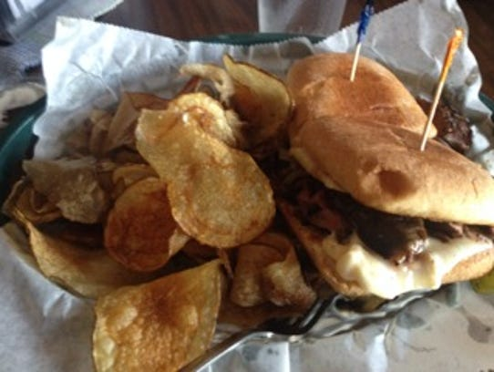 Homemade potato chips and a Philly steak sandwich from