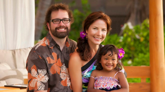 Jed Taufer and Vicki Taufer of Morton, Ill., and their adopted daughter, Purnima, visit Kona, Hawaii, in May 2012.  The Taufers, who adopted Purnima from Nepal, found the Internet invaluable during the process. They were able to communicate regularly by Skype during the six months in 2010-11 when Vicki stayed with Purnima in Katmandu waiting for authorization. They also relied on the Internet to build friendships with other families struggling to complete adoptions from Nepal.