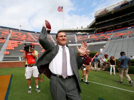 Dan Mullen, the Mississippi State football coach at the time, throws a football before a 2017 game against the Auburn Tigers at Jordan-Hare Stadium.