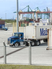 Tractor drivers maneuver their containers inside the expanded container yard at the Port Authority of Guam on Cabras Island on Wednesday, Dec. 9. A ribbon cutting ceremony was held to celebrate the completion of the final phase of the Guam Commercial Port Improvement Program.