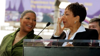 "Actress Queen Latifah, left, smiles at her mother Rita Owens during a ceremony honoring Latifah with the first Hollywood Walk of Fame star of the year Wednesday, Jan. 4, 2006, in Los Angeles.  Latifah is currently starring in ""Last Holiday,"" which will be released nationwide Jan. 13.  (AP Photo/Nick Ut)"