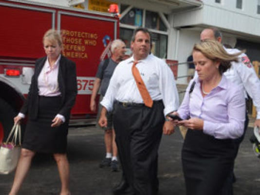 Gov. Chris Christie and then-Deputy Chief of Staff Bridget Anne Kelly (R) walk at the scene of a boardwalk fire September 12, 2013 in Seaside Heights. (Photo by Phil Stilton/Getty Images)