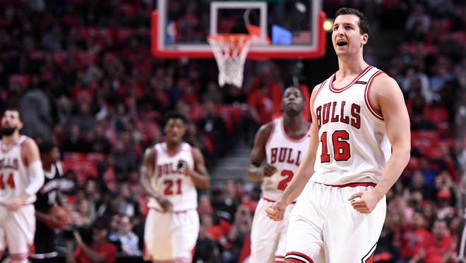 Chicago Bulls forward Paul Zipser (16) reacts after making a three point basket against the Brooklyn Nets during the first half at the United Center.