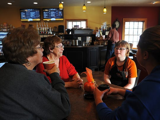 Laura Lems, second from right, 22, of Canton talks with her grandmothers Alice Lems, left and Evelyn Pederson, second from left, who both live near Canton; and her cousin, Brianna Buseman, right, 20, of Canistota Tuesday at Laura's Lattes.