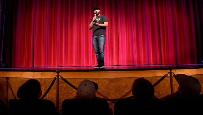 """Chad Mitchell addresses the audience prior to the screening of a clip from """"My Brother's Keeper"""" Friday at the Paramount Theatre. The film depicts the Abilene High School 2009 championship football season of which Mitchell was a part, and whom is characterized in the movie."""