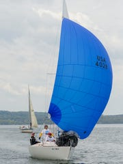 David Feavearyear's J24, Snitch, flying a spinnaker, leads Eberhard Alsen's Tanzer 25, Fantasy, during a May race organized by the Cruising Fleet at the Ithaca Yacht Club on Cayuga Lake.