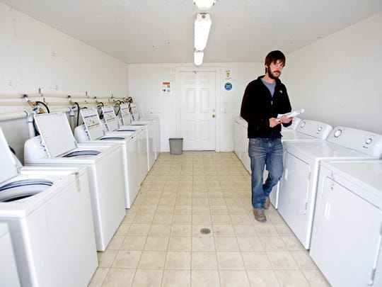 John Hamby, co-owner and operator of Pumpkin Patch Fundraisers, Inc., walks through the laundry room on Wednesday at the business' headquarters south of Farmington.