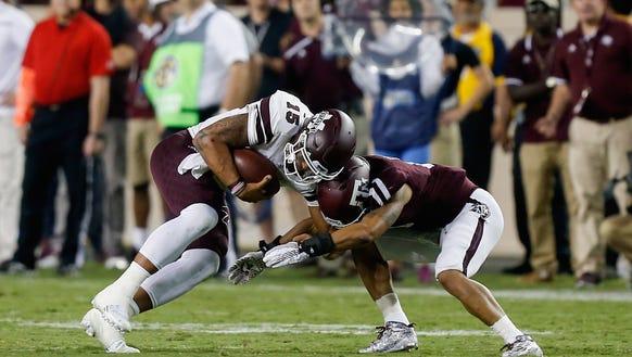 Mississippi State quarterback Dak Prescott (15) lowers
