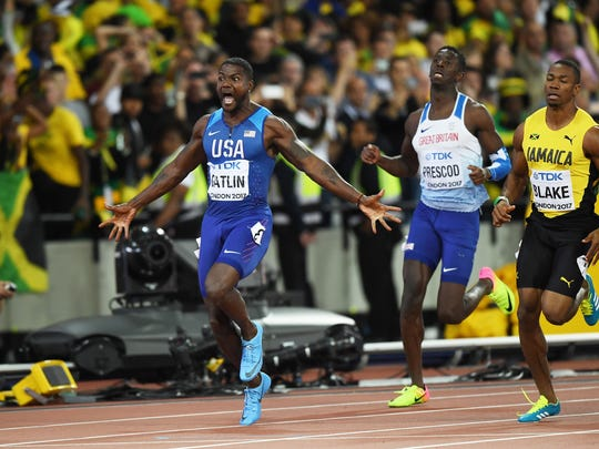 Justin Gatlin of the United States raises his arms