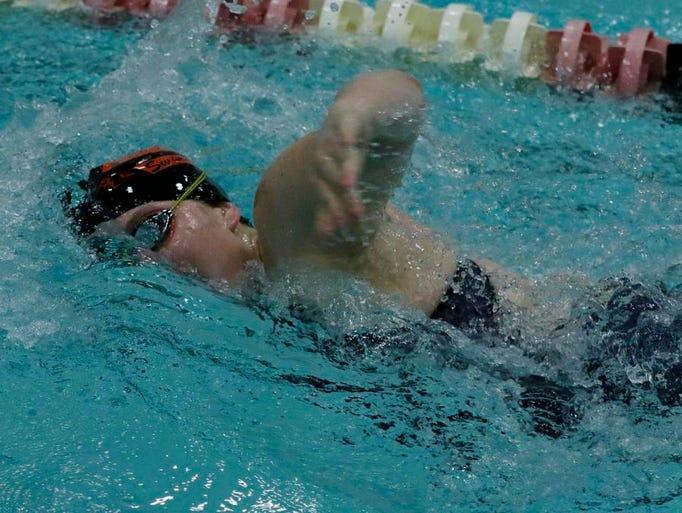 Plymouth's Keeley Kuru swims the third leg of the 400