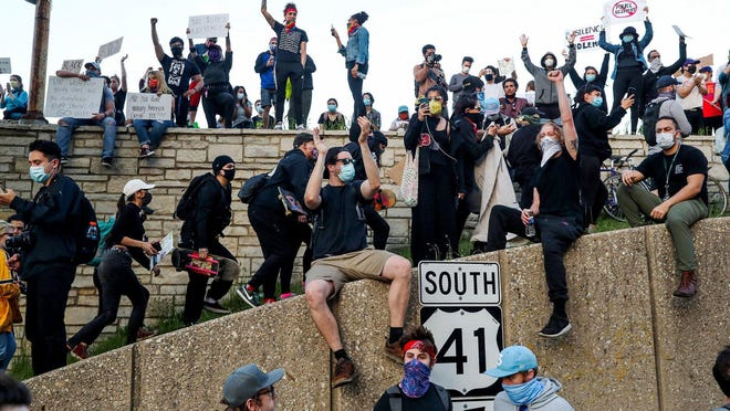 Protesters climb the Irving Park Road ramp to Lake Shore Drive on Monday, June 1 in Chicago.