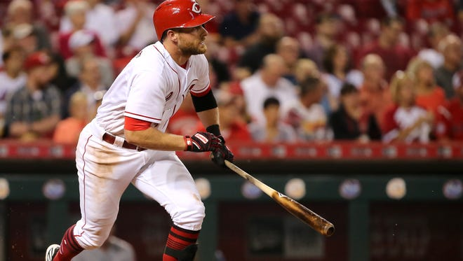 Cincinnati Reds shortstop Zack Cozart (2) hits a single during the National League baseball game between the New York Mets and the Cincinnati Reds, Tuesday, Aug. 29, 2017, at Great American Ball Park in Cincinnati.